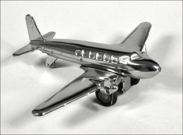 moving a collection, tin toy airplane