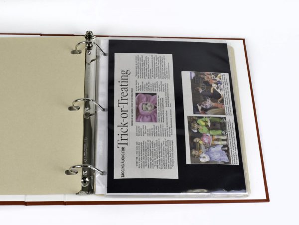 storing newspaper clippings, binder, archival storage